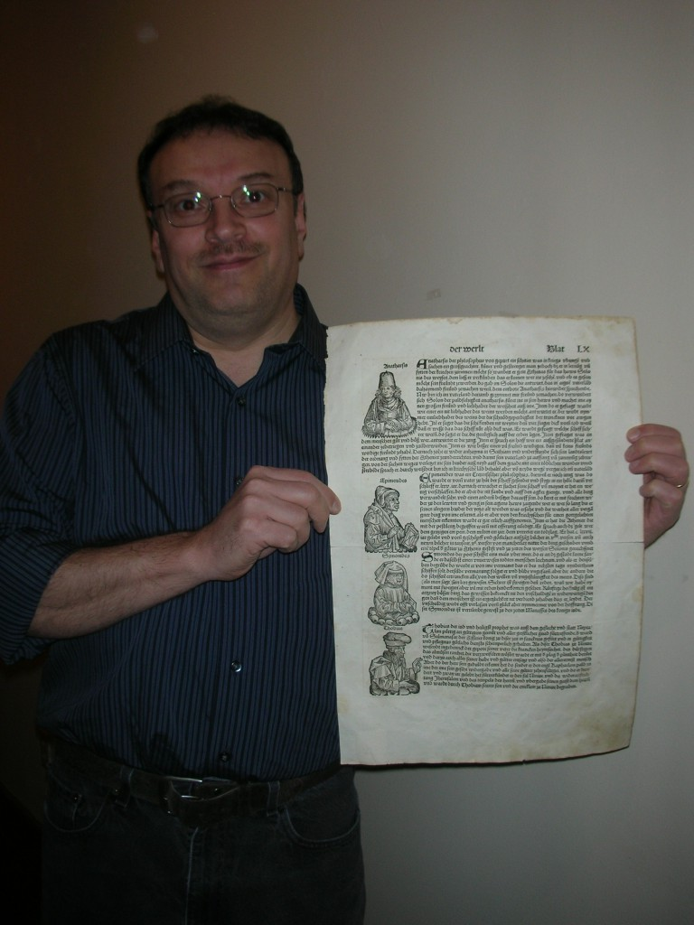 Chris Obert with 500 year old book page