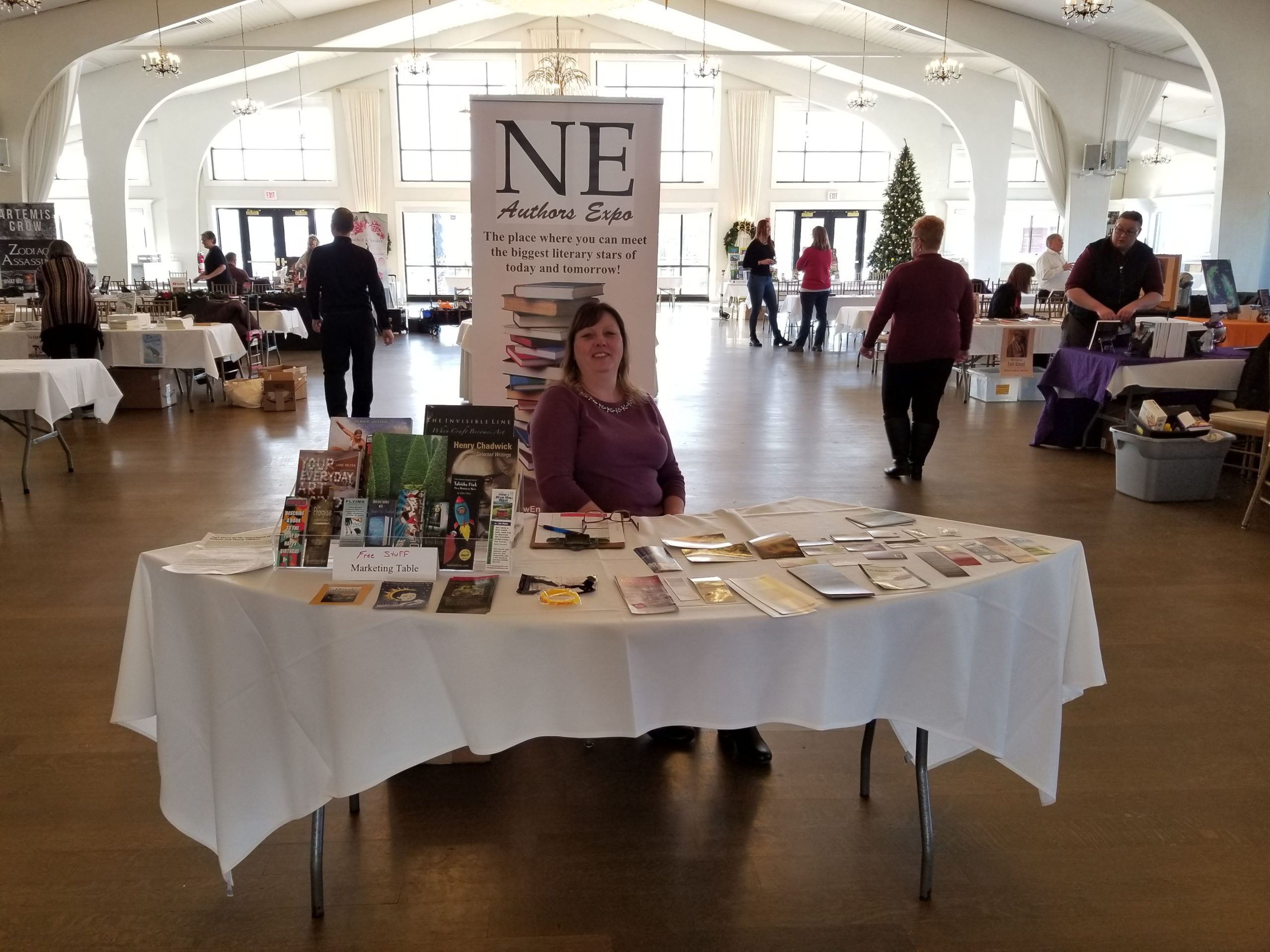 Nancy Obert at the New England Authors Expo Welcome Table
